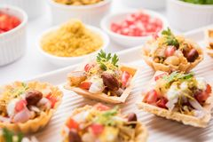 Crispy Canape or canapé is an indian Chat menu. Crispy Canape or canapé is a starter recipe from India - Round or square shaped Puri Filled with Yogurt and royalty free stock photography