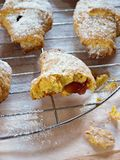 Crispy carrot crescents. Sweet caroot crescent with jam fillinf royalty free stock photo