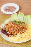 Crispy catfish with green mango salad, popular food in Thailand. Royalty Free Stock Photos