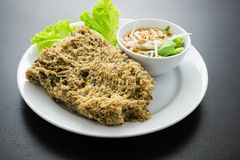Crispy catfish salad with green mango. For Restaurant menu Stock Photography