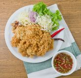 Crispy Catfish Salad with Green Mango and Vegetable Stock Photo