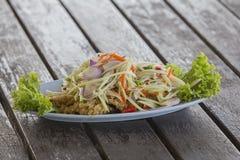 Crispy catfish salad with green mango and vegetable. Yam pra duk fu Stock Images
