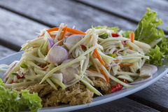 Crispy catfish salad with green mango and vegetable. Yam pra duk fu Royalty Free Stock Photo