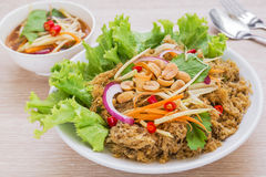 Crispy catfish spicy salad with green mango, Thai food Royalty Free Stock Images