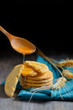 Crispy cereal cookies and honey Stock Photos