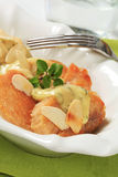 Crispy chicken breast with cream sauce and almonds Royalty Free Stock Images