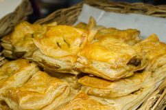 Crispy chicken pie with wooden basket royalty free stock photos