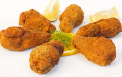 Crispy chicken wings. On white background stock image