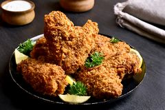 Crispy chicken wings. Appetizing crispy chicken wings. Dish for dinner. Close up view royalty free stock images
