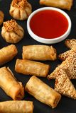 Crispy Chicken wontons, vegetable spring rolls and prawn toasts with sweet chilli sauce. chinese selection. fast food. stock image