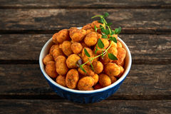 Crispy chilli peanuts snacks in bowl Royalty Free Stock Images