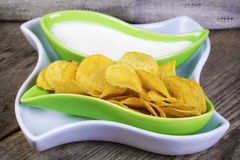 Crispy chips in green bowl Stock Photo
