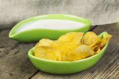 Crispy chips in green bowl Stock Images