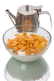 Crispy corn flakes and milkman. Crispy corn flakes with reflection isolated on white background Royalty Free Stock Image