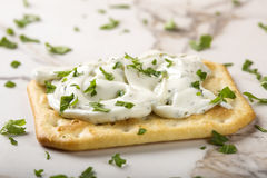 Crispy crackers with cream cheese Stock Images