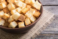 Crispy croutons in bowl Royalty Free Stock Photography