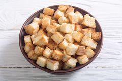 Crispy croutons in bowl Royalty Free Stock Photo