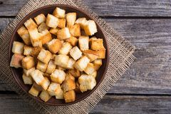 Crispy croutons in bowl Stock Photos