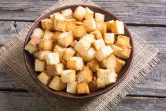 Crispy croutons in bowl. Food background royalty free stock photography