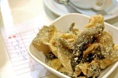 Crispy deep fried fish skin snack in Hong Kong. Crispy deep fried salmon king fish skin snack in Hong Kong Royalty Free Stock Photos