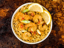 Crispy Deep Fried Prawns With Sweet Chilli Sauce and Noodles. Against A Distressed Baking or Oven Tray Royalty Free Stock Images