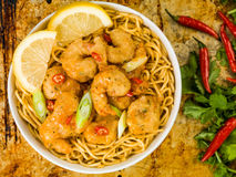Crispy Deep Fried Prawns With Sweet Chilli Sauce and Noodles. Against A Distressed Baking or Oven Tray Stock Images