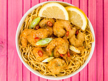 Crispy Deep Fried Prawns With Sweet Chilli Sauce and Noodles. Against A Wooden Pink Background Stock Photo