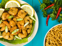 Crispy Deep Fried Prawns With Sweet Chilli Sauce and Noodles. Against A Blue Wooden Background Stock Photo