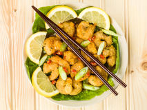 Crispy Deep Fried Prawns With Sweet Chilli Sauce and Noodles. Against A Light Pine Wood Background Royalty Free Stock Image