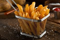 French Fries. Crispy delicious french fries in a fryer basket Royalty Free Stock Images