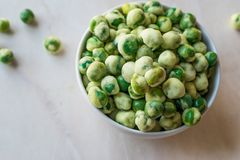 Crispy Dry Spiced Green Wasabi Peas as an Appetizer. Royalty Free Stock Image