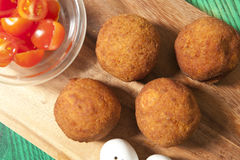 Crispy Falafel Balls with tomatoes on the wood board royalty free stock image