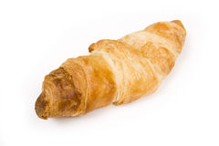 Crispy, flaky croissant. A single croissant on a white background Stock Image