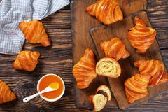 Crispy french croissants and apricot jam Royalty Free Stock Image
