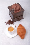 Crispy fresh croissants, cup of coffee espresso and coffee grinder on a white background, morning breakfast, selective Royalty Free Stock Photos