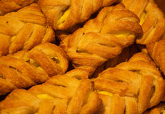 Crispy fresh rolls background. Plenty of the baked rolls Royalty Free Stock Photography