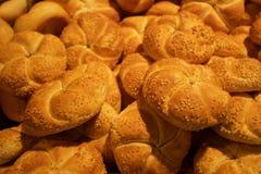 Crispy fresh rolls background. Plenty of the baked rolls Stock Images