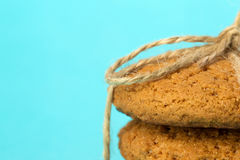Crispy freshly baked oatmeal cookies. On a bright background Royalty Free Stock Photos