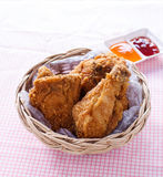 Crispy fried chicken in a basket royalty free stock photo