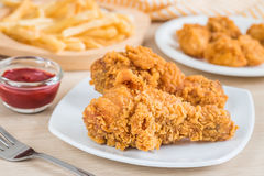 Crispy fried chicken and french fries Stock Photos
