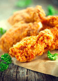 Crispy fried chicken wings on wooden table Stock Photo