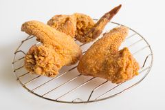 Crispy fried chicken on a wire rack. Crunchy crispy fried chicken on a wire rack stock photography