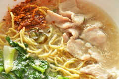 Crispy fried egg noodle dressing cayenne pepper and pickled chili in gravy sauce Stock Images