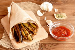 Crispy fried eggplant slices with a garlic, spices and tomato sauce Stock Photo