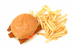 Crispy Fried Fish Sandwich And Fries Over White Background Stock Image
