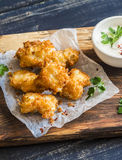 Crispy fried fish on a wooden  board. Crispy fried fish on a wooden rustic board Stock Photos