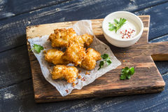 Crispy fried fish on a wooden rustic board. Crispy fried fish on a wooden  board Royalty Free Stock Photo