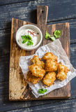Crispy fried fish on a wooden rustic board Stock Image