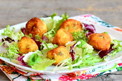 Crispy fried mashed potato balls. Delicious fried balls made from mashed potatoes with pumpkin seeds served with salad leaves mix Royalty Free Stock Photos