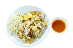 Crispy fried mussel and squid omelet with bean sprout dipping chili sauce on white background Stock Image